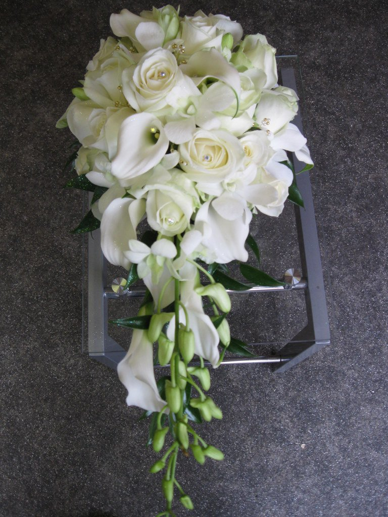 Avalanche rose cala lily and dendrobium orchid bouquet fleurt in